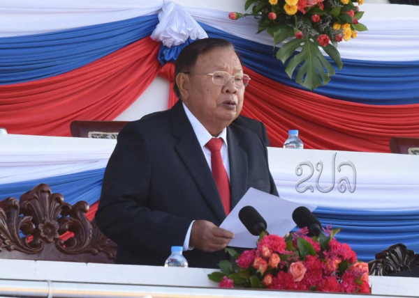 LPRP Secretary General, President of Laos Mr Bounnhang Vorachit speaks at Lao People's Armed Forces 70th Anniversary Parade. (Image KPL)